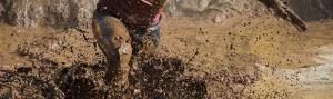 Person running in mud